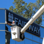 Fairway Investments sign applied to building